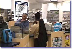 Pharmacist dispensing medicine at the pharmacy